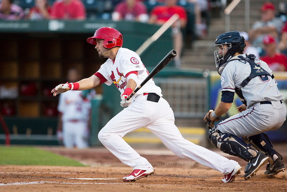 Luis Mateo (26) of the Springfield Cardinals follows through his swing after making contact on a pitch during a game against the Northwest Arkansas Naturals at Hammons Field on August 20, 2013 in Springfield, Missouri. (David Welker)