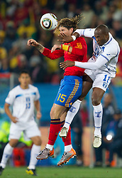 Sergio Ramos of Spain vs Joan Capdevila of Honduras during the 2010 FIFA World Cup South Africa Group H Second Round match between Spain and Honduras on June 21, 2010 at Ellis Park Stadium, Johannesburg, South Africa.   (Photo by Vid Ponikvar / Sportida)