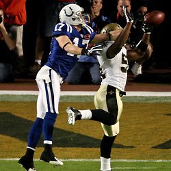 2010 February 07: New Orleans Saints linebacker Jonathan Vilma (51) breaks up a pass against Indianapolis Colts wide receiver Austin Collie (17) during a 31-17 win by the New Orleans Saints over the Indianapolis Colts in Super Bowl XLIV at Sun Life Stadium in Miami, Florida.