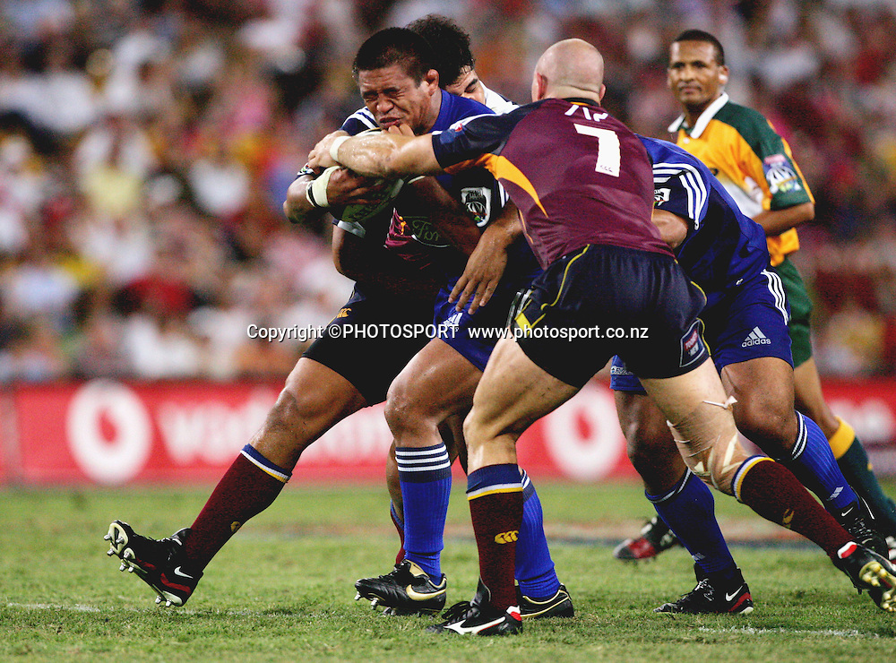 Keven Mealamu is stopped by David Croft during the 2006 Super 14 rugby union match between the Reds and the Auckland Blues at Suncorp Stadium, Brisbane, Australia, on Saturday 25 February, 2006.Blues defeated Reds 21-20. Photo: PHOTOSPORT