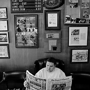 Waiting for a hair cut at Durdens Barber Shop in Augusta, Georgia. The barber shop has been a fixture in the community for over 50 years.
