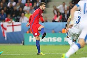 England Midfielder Adam Lallana shoots at goal during the Euro 2016 Group B match between Slovakia and England at Stade Geoffroy Guichard, Saint-Etienne, France on 20 June 2016. Photo by Phil Duncan.