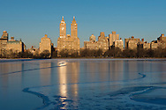 A view over the frozen Jacqueline Kennedy Onasis Reservoir toward Central Park West and the towers of the El Dorado building;  Manhattan, New York City, New York State, U.S.A.