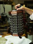 "A concertina at Homewood Musical Instrument Company, where owner Bob Tedrow has been making concertinas since the mid-1990's. ""It's an incredible work of art,"" Tedrow said. ""There's just no other instrument that combines charming workmanship and early 19th century craftsmanship, all with the portability of a six pack of beer."""