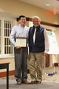 Dr. Xiaozhuo Chen poses for a photo with Dr. John Kopchick onstage after recieving his John J. Kopchick Molecular and Cellular Biology Translational Biomedical Sciences Faculty Support Fund award in Nelson Commons on Saturday, November 14, 2015. Photo by Kaitlin Owens
