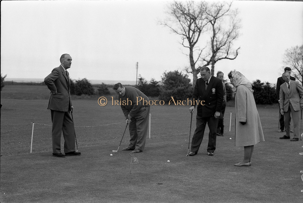 23/05/1963<br /> 05/23/1963<br /> 23 May 1963<br /> Esso Staff Golf Outing at Woodbrook Golf Club, Co. Dublin. Image shows members of staff golfing on the course that day. Member of staff about to putt.