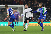 Derby County defender Richard Keogh wins the ball during the EFL Sky Bet Championship match between Derby County and Wigan Athletic at the Pride Park, Derby, England on 5 March 2019.