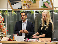 Dr. Mohit Chawla (from left) of Cardiologists, L.C. talks about various foods health benefits as Kara Behike, Hy-Vee Dietitian, chops up some fresh spinach during Cooking with a Cardiologist at Hy-Vee in Marion on Thursday, November 10, 2011. The event was hosted by Cardiologists, L.C. and Hy-Vee. (Stephen Mally/Freelance)