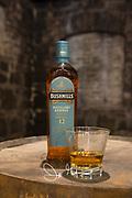 Bushmills whisky displayed ona barrel in a warehouse at the Bushmills distillery in Bushmills, County Antrim, Northern Ireland, U.K.