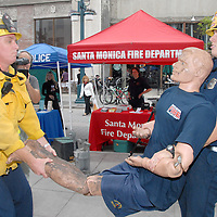 Santa Monica Firefighters Joe Cavin (right) and Jim Schier demonstrate how to properly move an injured victim during the Great Southern California Shakeout, a statewide earthquake drill, at the Third Street Promenade on Thursday, October 21, 2010.