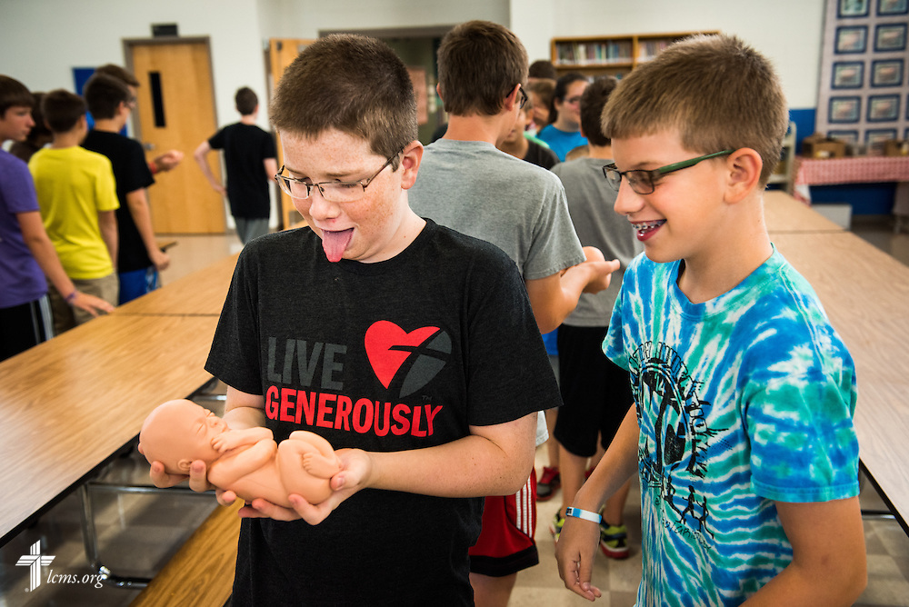 Students react to a fetal development model following an Owen's Mission presentation at Trinity Lutheran School on Monday, August 31, 2015, in Bloomington, Ill. LCMS Communications/Erik M. Lunsford