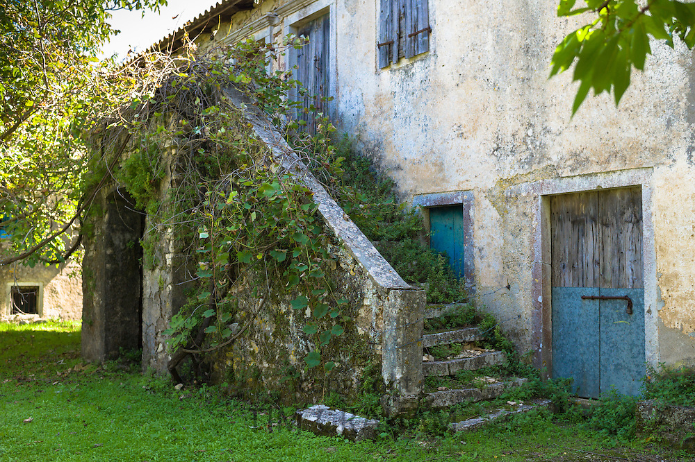 Derelict house with traditional outside staircase in ancient village of Old Perithia - Palea Perithea, Northern Corfu, , Greece