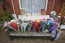 © Licensed to London News Pictures . 13/10/2014 . Manchester , UK . Flowers , tributes and candles outside the home of Jordan Brennan , Peacock Grove , Gorton , as police in Manchester have launched a murder investigation after 17 year old Jordan Brennan was found dead in his bed by his mother . Jordan died following an assault outside a shop near his home in Gorton , Manchester . His mother found him unresponsive in his bed 14 hours after the attack and paramedics pronounced him dead at the scene . The attack took place outside a local grocer's shop . Police want to speak to a man and a woman , both aged 25-30 years old and of Chinese appearance , who were recorded on CCTV in the shop at the time . Photo credit : Joel Goodman/LNP