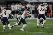 Chase Daniel (QB) of the Chicago Bears hands off ball to David Montgomery (RB) of the Chicago Bears  during the International Series match between Chicago Bears and Oakland Raiders at Tottenham Hotspur Stadium, London, United Kingdom on 6 October 2019.