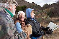 Family hiking in desert