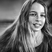 Black and white portrait of a happy young girl