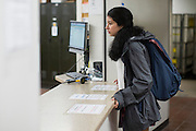 Sabrina Villanueva picks up a package at the campus post office at the University of Rochester in Rochester, New York on August 31, 2016. Villanueva earned 12 credits through a community college while in high school in Dallas, but the University didn't accept them, causing her to pursue a minor in Spanish rather than sociology or psychology as she had originally intended.