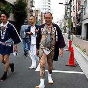 TOKYO, JAPAN - MAY 14: A man with tattoo is proudly walking and displaying his tattoos during the second day of the Sanja Matsuri Festival in Tokyo's Asakusa district on May 14, 2016. This festival is one of the rare times when members of the notorious Yakuza gang reveal themselves to public and take photo with festival goers.<br /> <br /> <br /> Photo: Richard Atrero de Guzman