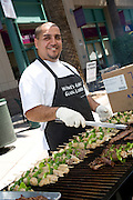 A Vendor Grilling Chicken and Beef Kabobs at the Downtown Anaheim Farmer's Market