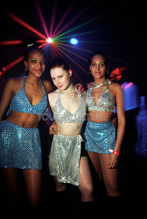 Three girls with sparkle clothes at a rave, one nation, adrenalin village, 15th feb 1997