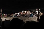bari imam shrine, islamabad, pakistan 2004: women pilgrims with their children listen to a qawwali concert from a terrace<br />