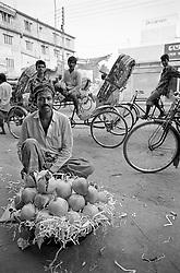 BANGLADESH DHAKA JUL94 - A fruit seller displays his wares in a basket in downtown Dhaka, Bangladesh...jre/Photo by Jiri Rezac..© Jiri Rezac 1994