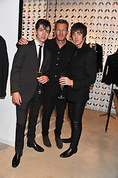 Left to right, singer ALEX TURNER of the Artic Monkeys, NICK HART and MILES KANE at the launch of the Spencer Hart Flagship store, Brook Steet, London on 13th September 2011.