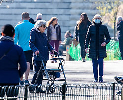 © Licensed to London News Pictures. 25/03/2020. London, UK. An elderly women exercises in St James's Park on the 2nd day of lockdown as Prime Minister Boris Johnson orders police to enforced the new social distancing rules. Meanwhile Prince Charles is confirmed to have contracted Covid19 as the crisis continues. Photo credit: Alex Lentati/LNP