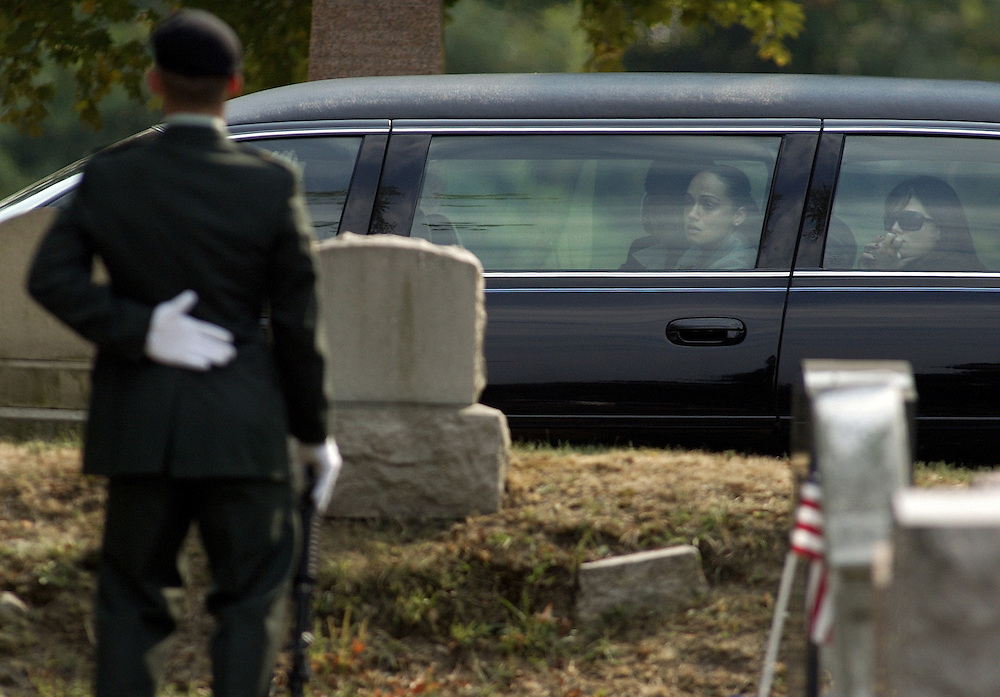 (100607  Cambridge, MA)   Friends and family grieve during the internment for slain police officer Daniel Talbot.  His fiance, Connie Bethel, looks out the window of their limo as they drive through the cemetery.