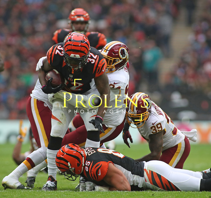 NFL International Series 2016 Washington Redskins @ Cincinnati Bengals 30th OCT 2016<br /> <br /> Cincinnati Bengals Running Back Jeremy Hill (32) is tackled by Washington Redskins Line Backer Preston Smith (94) during game 17 of the NFL International Series between the  Washington Redskins and Cincinnati Bengals, From Wembley Stadium, London.<br /> <br /> Pic Micthell Gunn / PLPA? ProLens Photo Agency.<br /> Sunday 30 October 2016