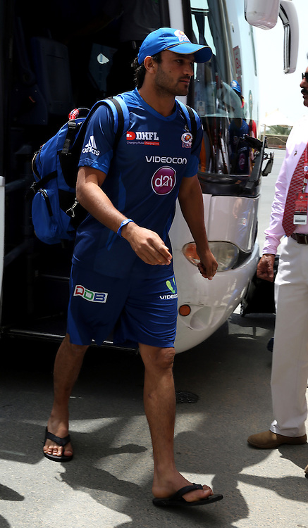 Pawan Suyal of the Mumbai Indians walks in before the match  match 5 of the Pepsi Indian Premier League Season 7 between the Royal Challengers Bangalore and the Mumbai Indians held at the Dubai International Cricket Stadium, Dubai, United Arab Emirates on the 19th April 2014<br /> <br /> Photo by Sandeep Shetty / IPL / SPORTZPICS