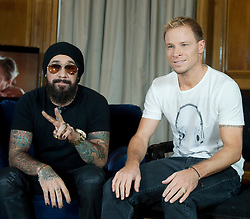 In the image - (L-R) A.J. Maclean and Brien Littrell.<br /> The Backstreet Boys,  (L-R) Kevin Richardson, Howie Dorough, Nick Carter, A.J. Maclean and Brien Littrell visit Spain to celebrate their 20th anniversary. The group that revolutionised a decade has been reunited to celebrate their 20th anniversary in the music world, Madrid, Spain, Tuesday, 12th November 2013. Picture by DyD Fotografos / i-Images<br /> SPAIN OUT