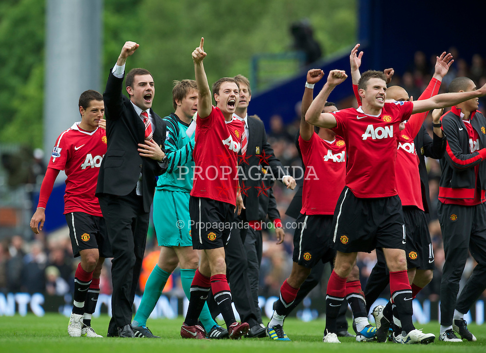 BLACKBURN, ENGLAND - Saturday, May 14, 2011: Manchester United's Jonathan Evans celebrates winning the FA Premier League after his side scrapped a 1-1 draw with Blackburn Rovers during the Premiership match at Ewood Park. (Photo by David Rawcliffe/Propaganda)