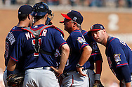 July 10, 2010: Minnesota Twins right fielder Michael Cuddyer (5) listen in on a meeting on the mound between Minnesota Twins catcher Joe Mauer (7), Minnesota Twins starting pitcher Nick Blackburn (53), Minnesota Twins pitching coach Rick Anderson (40) during the MLB baseball game between the Minnesota Twins and Detroit Tigers at  Comerica Park in Detroit, Michigan.