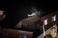 VATICAN CITY - 13 MARCH 2013: A puff of white smoke comes out of the chimney of the Sistine Chapel, where the conclave is taking place, announces to the outer world that a new Pope has been elected, in Vatican City, on March 13, 2013. The 115 cardinals picked a new pope among their midst on the second day of the conclave, choosing Jorge Mario Bergoglio from Argentina, the first South American pope to lead the church. Jose Mario Bergoglio, called Francis I, is the 266th pontiff of the Roman Catholic Church...On March 12, 2013, the 115 cardinals entered the conclave to elect a successor to Pope Benedict XVI after he became the first pope in 600 years to resign from the role. The conclave will take place inside the Sistine Chapel and will be attended by 115 cardinals as they vote to select the 266th Pope of the Catholic Church.