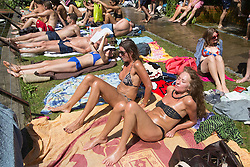 © licensed to London News Pictures. London, UK 01/08/2013. People sunbathing and enjoying hot weather at Hampstead Heath Park Mixed Bathing Pond in north London on Thursday, August 1, 2013. Photo credit: Tolga Akmen/LNP