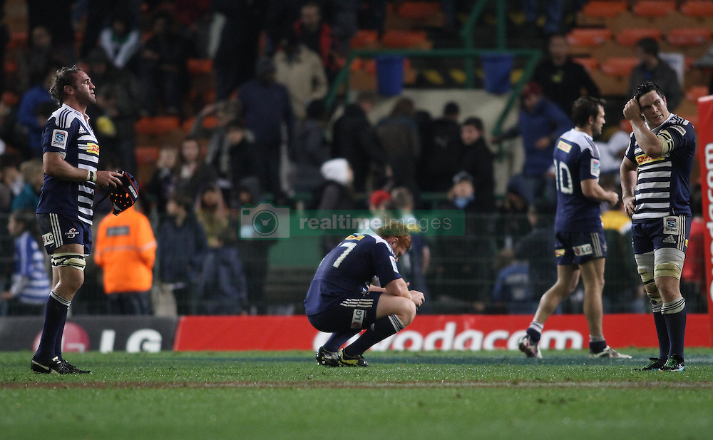 Dejected Stormers players Anton van Zyl, Steven Kitshoff, Peter Grant and Francois Louw after losing to the Crusaders during the Super Rugby Semi-Final match between DHL Stormers and the Crusaders held at DHL Newlands Stadium in Cape Town, South Africa on 2 July 2011...Photo by Shaun Roy / Sportzpics.net