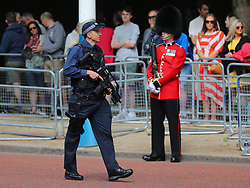 © Licensed to London News Pictures. 09/06/2018. London, UK. Armed police on The Mall as Royal fans wait to see members of the Royal family attend Trooping The Colour ceremony in London to mark the 92nd birthday of Queen Elizabeth II, Britain's longest reigning monarch. Photo credit: Rob Pinney/LNP