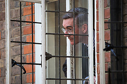 London, UK. 23 July, 2019. Jacob Rees-Mogg MP, Chairperson of the pro-Brexit European Research Group (ERG), leans out of a window during a celebration in Westminster of Boris Johnson's election as Conservative Party leader and replacement of Theresa May as Prime Minister organised by the ERG.