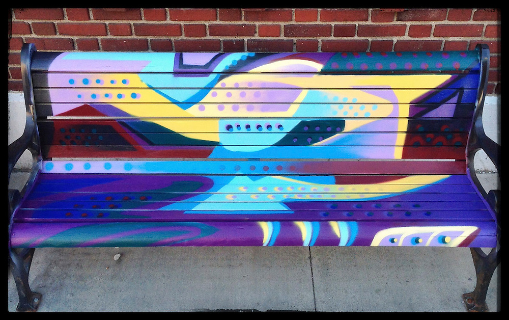 Painted on public benches in the Iowa City Pedestrian Mall in conjunction with the city's public art project.