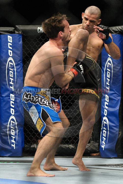 "BIRMINGHAM, ENGLAND, NOVEMBER 5, 2012: Brad Pickett (left) is rocked by a knee strike from Renan Barao during ""UFC 138: Munoz vs. Leben"" inside the National Indoor Arena in Birmingham, United Kingdom"