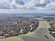 Nederland, Zuid-Holland, Dordrecht, 25-02-2020; samenstroming van de rivieren Oude Maas, de Noord en Beneden Merwede. Binnenstad van Dordrecht en spoorbrug, rechts Zwijndrecht. Dordtsche Kil en Hollandsch Diep aan de horizon.<br /> Confluence of the rivers Oude Maas, Noord and Beneden Merwede. Historical city centre Dordrecht.<br /> <br /> luchtfoto (toeslag op standard tarieven);<br /> aerial photo (additional fee required)<br /> copyright © 2020 foto/photo Siebe Swart