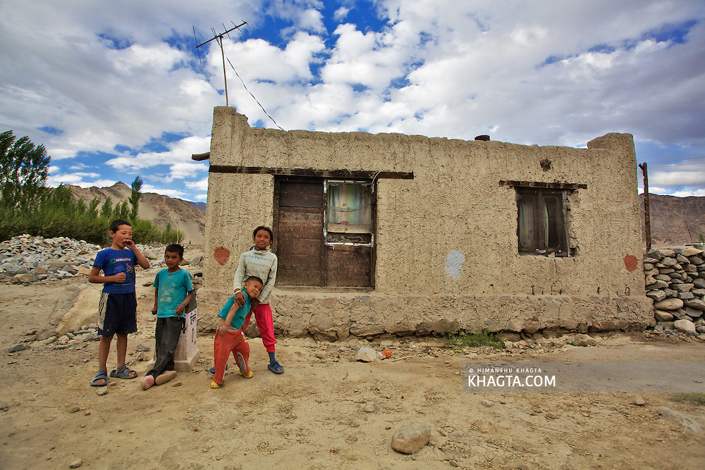 Kids standing outside a house in village Thiksey, few miles from Leh Town.