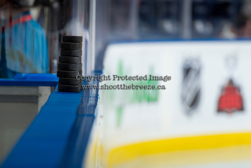 KELOWNA, CANADA - OCTOBER 21: Pucks rest on the boards on October 21, 2017 at Prospera Place in Kelowna, British Columbia, Canada.  (Photo by Marissa Baecker/Shoot the Breeze)  *** Local Caption ***