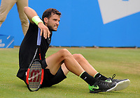 Tennis - 2017 Aegon Championships [Queen's Club Championship] - Day Six, Saturday<br /> <br /> Men's Singles, Semi Finals<br /> Grigor Dimitrov [Bul] vs. Feliciano Lopez [Esp]<br /> <br /> Grigor Dimitrov slips on the grass on Centre Court <br /> <br /> COLORSPORT/ANDREW COWIE