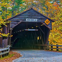 The historic Durgin Covered Bridge framed by New England fall foliage. Durgin Covered Bridge spans the Cold River and is located in Sandwich, New Hampshire.<br /> <br /> New England fall foliage and Durgin Covered Bridge photography images are available as museum quality photography prints, canvas prints, acrylic prints or metal prints. Prints may be framed and matted to the individual liking and decorating needs:<br /> <br /> https://juergen-roth.pixels.com/featured/fall-foliage-and-durgin-covered-bridge-juergen-roth.html<br /> <br /> All high resolution New Hampshire Covered Bridge photography images are available for photo image licensing at www.RothGalleries.com. Please contact me directly with any questions or request. <br /> <br /> Good light and happy photo making!<br /> <br /> My best,<br /> <br /> Juergen<br /> Photo Prints: http://www.rothgalleries.com<br /> Photo Blog: http://whereintheworldisjuergen.blogspot.com<br /> Instagram: https://www.instagram.com/rothgalleries<br /> Twitter: https://twitter.com/naturefineart<br /> Facebook: https://www.facebook.com/naturefineart