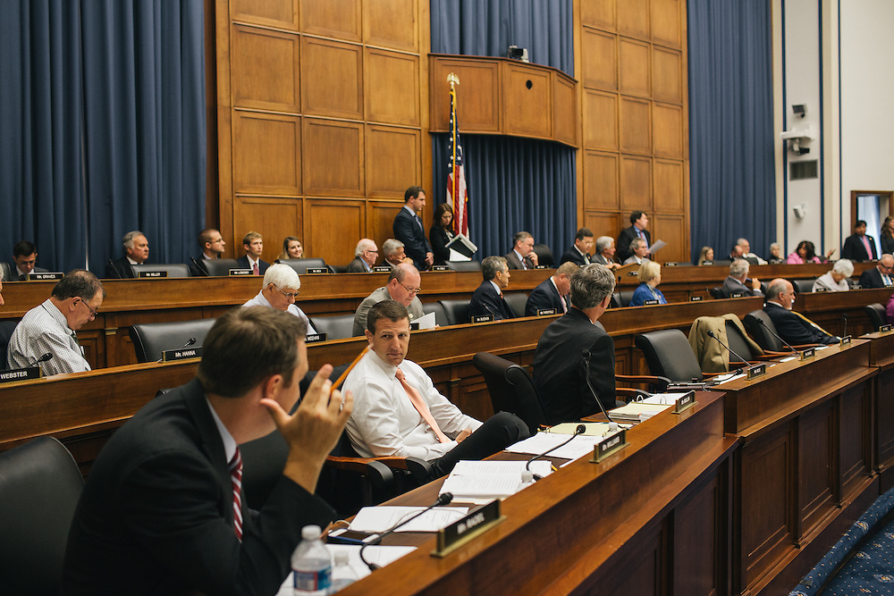 Congressman Markwayne Mullin talks with congressman Trey Radel of Florida during the Transportation and Infastructure committee's meeting on Sept. 19, 2013. During the meeting, the committee passed the Water Resources Reform and Development Act of 2013, a bipartisan bill.