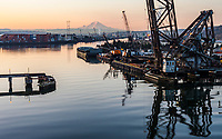 The Duwamish river /waterway in Seattle, Washington looking south under the West Seattle Freeway bridge with Mount Rainier in the distance.