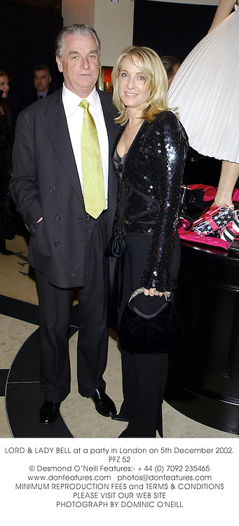 LORD & LADY BELL at a party in London on 5th December 2002.PFZ 52