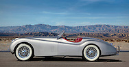 Profile of a silver 1954 XK 120 Jaguar photographed in the Desert of Palm Springs, CA